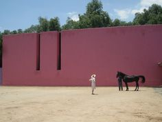 Dreams of a bright outdoor accent wall: Architect Luis Barragán's Caudra San Christobál Stables | Remodelista