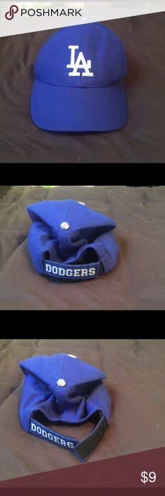MLB Dodgers official classic blue & white hat!! MLB Dodgers official classic blue & white hat!!  It's the original dodger blue with the white LA in the front if you are a dodger fan you must own this hat you probably do it's great for men and women it's one-size-fits-all with Velcro it really can fit anybody MLB Accessories Hats