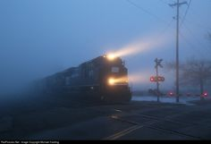 Looming out of a thick morning fog the PC Heritage unit heads down to 289 for a crew change in Toledo before continuing to Bellevue.
