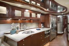 The revolutionary new design of the Brew Express for RV's blends style, performance and convenience into an easy-to-use appliance that makes brewing coffee and hot beverages a pleasure instead of a burden. Built In Coffee Maker, Brewing, Rv, Beverages, Kitchen Cabinets, Appliances, Building, Easy, Design