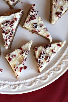 """This week, I baked Cranberry Bliss Bars. The recipe originally comes from Taste of Home. They call them """"White Chocolate Cranberry Blondies,"""" but if you're a Starbuck's fan… they're clearly Cranberry Bliss Bars. Holiday Desserts, Holiday Baking, Christmas Baking, Holiday Recipes, Holiday Cookies, Holiday Ideas, Christmas Recipes, Holiday Appetizers, Christmas Sweets"""