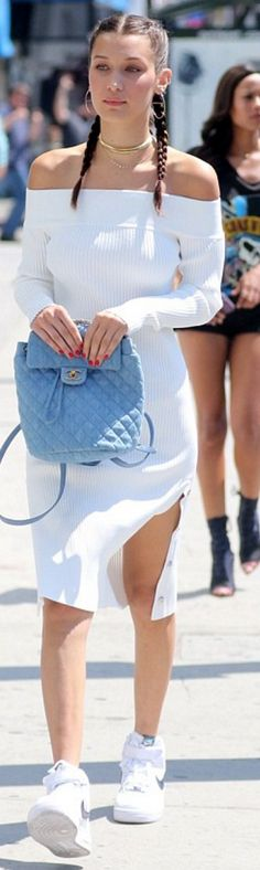Who made Bella Hadid's blue quilted backpack, white ribbed dress, and sneakers?