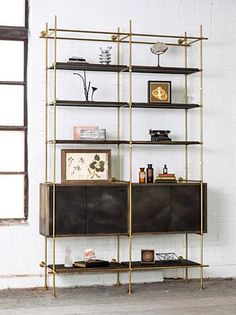 Amuneal / written about on http://www.remodelista.com/posts/storage-furniture-brass-shelving-from-amuneal