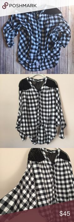 LF Flannel Dolman-Style Button Down High-Low Shirt LF Furst of a Kind Black & White Flannel Dolman-Style Button Down Long Sleeved High-Low Shirt. NWT, S. Very generous fit. Materials, 65% cotton, 35% polyester.   ⭐️ Bundle & Save, No Trades ⭐️ Posh Compliant, Posh Rules Only ⭐️ All Offers Accepted or Countered ⭐️ Smoke & Pet Free Environment LF Tops Button Down Shirts