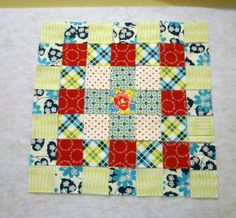 Love me a patchy block -- and this one has a rose in the center -- {Swoon!}  Freda's Daughter is a genius!