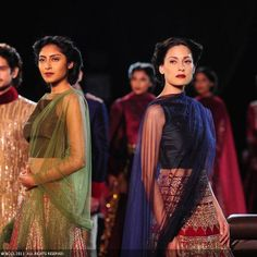 Michelle Singh aand other models walk the ramp for designer Manish Malhotra on Day 5 of Delhi Couture Week, held in New Delhi, on August 04, 2013.