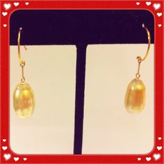 A south sea pearl drop earrings in 14k gold.  Good luster slight blemishes.  Priced at $268.