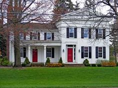 Dream house! But with a wrap around porch. White House, black shutters, red door
