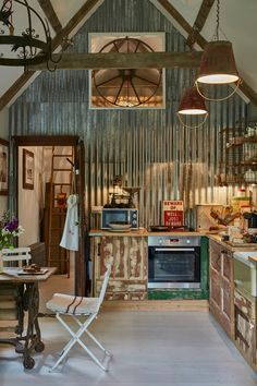 Eclectic Home Tour of Filly Island - a Cotswold cottage with lots of upcycled and repurposed and vintage finds like this metal corrugated wall kellyelko.com
