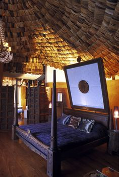 The Ngorongoro Crater Lodge - astounding bed - was it two queens put together?  The Tanzanian carved bed was amazing.