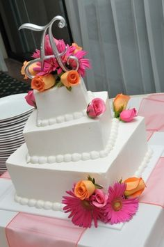 The resort cake...but don't know if I want the roses- maybe just Gerber daisies