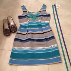 Ann Taylor Loft Striped Dress and 2 Belts Cute striped dress for Spring and Summer! Pleated at waist and darted at the bust. Zippered on the side and IT HAS POCKETS! The pockets do not pucker in the front, so it does not add to your figure! Both belts in the photo are included. Blue, green, navy, yellow, taupe and white stripes. Ann Taylor Loft Dresses Midi
