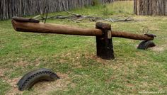 rustic playground | This see-saw is a masterpiece of recycling.