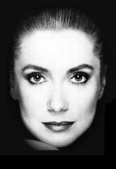 Catherine Deneuve. Close observation. There is strong shadow around the face, and lack of shadow on the face, which allows the audience to explore the facial expression without manipulation.