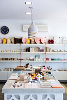 Shelves full of art and homewares, and what looks like it could be a concrete table - this is the shop and workspace of Studio Bomba in Leederville, Western Australia