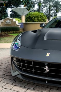 Matte black Ferrari F12 Berlinetta. Similar to the Lamborghini but not the same. Really nice if you have the money to get this nice car