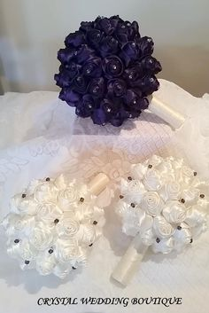 Accompanying the purple is bridesmaids ivory satin rolled roses interspersed with Swarovski purple velvet crystals