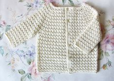 Hello and welcome! This is a listing for crochet pattern, if your wish is for purchasing the finished item you are welcome to visit https://www.etsy.com/ru/shop/KatyasCrochetNest Pattern is written in English. Diagrams are suitable for all languages. Cute baby cardigan with 3/4 sleeves.