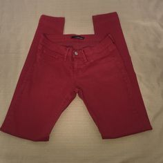 Flying Monkey Dark red skinny leg pants These are are dark brick red. Skinny leg pockets on front sides and back. There is some loose thread on the back pockets. Altar'd State Pants Skinny