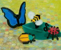Create this fun collection of pretty bugs with Perler Beads and a a few fun extras to give them a lifelike look! Set includes a butterfly, bee, beetle, and ladybug.