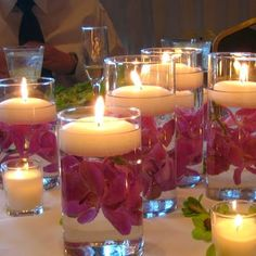floating candle centerpieces, how to make them, how to choose bowls and holders. Wedding centerpieces with floating candles you can make yourself. Diy Centerpieces Cheap, Floating Candle Centerpieces, Wedding Reception Centerpieces, Wedding Decorations, Centerpiece Ideas, Table Decorations, Reception Ideas, Orchid Centerpieces, Reception Table