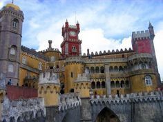 Offbeat Locations: Sintra, Portugal - via The Eudaimoniac   Sintra is a little like a model village of obscure buildings and castles hemmed into a mad micro-world by wondrous forests and exclusive golf resorts. It's the former summer residence of Portuguese royalty, testament to its refreshing air and home to some strange old edifices, including the multi-coloured Palácio da Pena.   Photo: Pena credit Leoplus