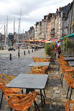 Honfleur, Normandy, France  loopy acrylic chairs at a sidewalk cafe  Oh Hell Yes!
