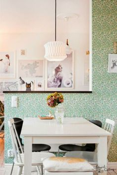 Add a splash of color to one wall of your kitchen with a bold colored wallpaper. We love this shade of green.