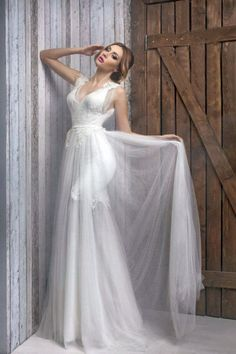white floor length sleeveless v neck long bridal dress with lace appliques