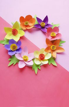 Paper Wreath Craft for Kids Made from Gorgeous Paper Flowers! Credits: momsandcrafters.com