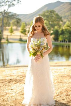 bridal portrait with countryside and lake in background #bride #countrywedding #weddingchicks