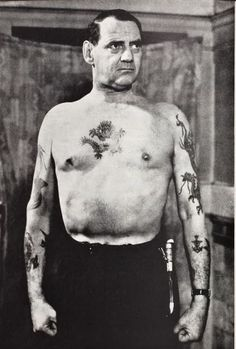 King Frederick IX of Denmark showing off his tattoos (1951).