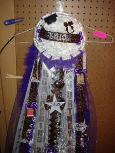 I make mums and garters for football homecomings!!! This a cheeta and purple one for a senior!!