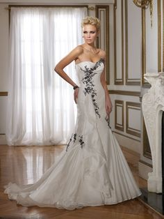 Amazing traditional mermaid style wedding gown with beautiful black accents