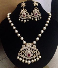 Peacock model CZ and ruby stone with pearl drops pendant and earrings Code : 417 Price : 1450/- Length : 18 inch short Whatsapp to 09581193795/- for order processing...