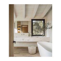 Letting the landscape in. . . . . Inspiration image - source unknown. . . . #bath #freestandingbath #bathdesign #stone #stonecounters #floating #floatingvanity #landscape