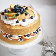 Summer Party Cake from Pillsbury® Baking is easy as baking two round cakes, leveling them and layering with frosting and fresh seasonal fruit! Simple, delicious & refreshing!