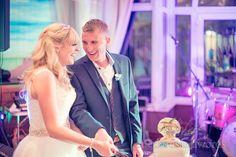 Bride and groom cutting wedding cake at Sandbanks Hotel Wedding. Photography by one thousand words wedding photographers