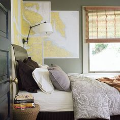 Great idea for a small area of wallpaper - maps!  Also like the swing arm lamp for saving space.