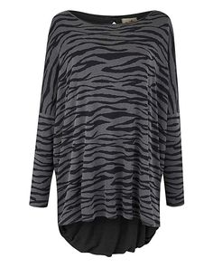 A Postcard From Brighton Split Back Top: This tiger print top from A Postcard from Brighton is the perfect casual wardrobe addition this…