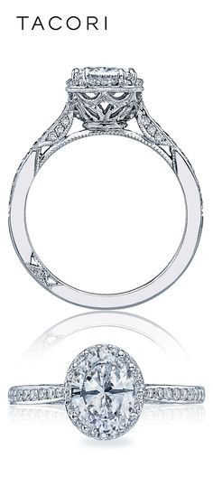 For a woman with an eye for glamour, this ring is sublime. Round diamonds encircle an oval center stone with diamonds both along the ceiling and on the sides, for lustrous shine from all angles.