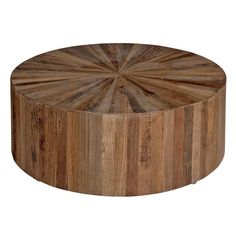 The circular Cyrano coffee table is inlaid with triangular offset pieces of recycled reclaimed elm wood. Simple in form but bold in design, the table is slightly elevated off the floor for added mobility and finished with a water based sealer. Drum Coffee Table, Circular Coffee Table, Round Wood Coffee Table, Reclaimed Wood Coffee Table, Rustic Coffee Tables, Wood Table, Drum Table, Natural Wood Coffee Table, Timber Table