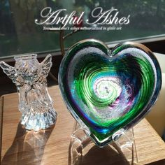 Artful Ashes... Your loved ones ashes memorialized within glass art... Greg and Christina 206-409-0337 www.artfulashes.com