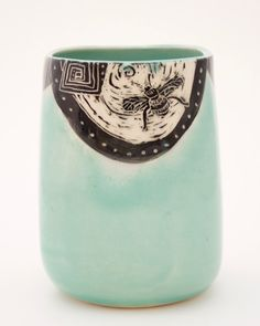 Bees are hand-etched on this cool vase by Patricia Griffin, ceramic artist-potter in Cambria, CA.
