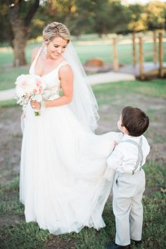 The sweetest ring bearer: http://www.stylemepretty.com/texas-weddings/2016/04/14/a-gorgeous-blush-texas-wedding-on-a-tight-budget/ | Photography: Tracy Enoch - http://www.tracyenoch.com/