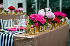 Pretty Pink Flowers Line the Head Table