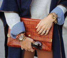 blue/brown coat, grey sweater, plaid, watch, bracelets, rust clutch