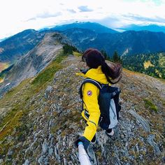 The @selkirktangiers helicopter dropped us off on that far ridge in front of me, and we hiked for 6km up and down the ridges around Ghost Peak, at 7500ft (2400mt). We crossed over a small glacier, along crumbling rock cliffs, and eventually down a steep hill to an alpine meadow. It all ended in a movie scene getaway, when the clouds opened up and rain started to pour as the helicopter swooped down to pick us up. Not a bad way to spend a Sunday.  @HelloBC @aqwaterproof