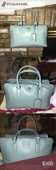TORY BURCH SQUARE SATCHEL -LARGE SIZE-rare color ! This is one AMAZING TORY BURCH bag that is a SQUARE SATCHEL and is a LARGE size. This is also in a GREAT color it's a light blue that is rare to find in Tory Burch Bags! This bag is extremely roomy inside! This comes with a REMOVABLE & ADJUSTABLE Strap. This Strap allows you to carry this TB in many ways. One is to wear it as a CROSS BODY another is a shoulder bag! And the last is to carry it as a tote!!Not many bags can do this! Tory Burch…