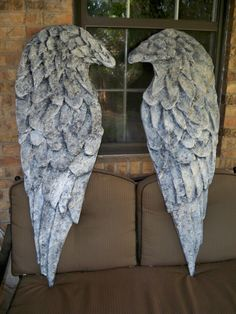 Angel wings made out of cardboard and paper mache.